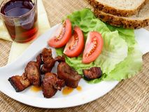 Slight lunch - meat. With salad and bread Royalty Free Stock Image