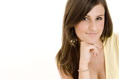 Slight Smile. A young woman gives a slight smile Stock Image