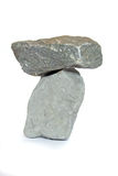 Slightly balanced. Two rocks one upon the other stock photos
