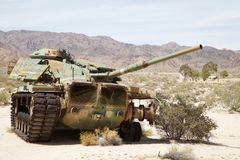 A slightly broken tank. An Army tank, slightly broken down with some missing pieces, sits in the California desert, awaiting repair and placement in a museum Stock Photos