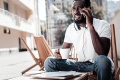 Slightly confused successful man listening to business partner on phone. Can you repeat pleas. Focused millennial entrepreneur listening to his business client Royalty Free Stock Photos