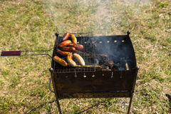 Slightly Cooked Meat Sausage on Barbecue Grill Stock Photo