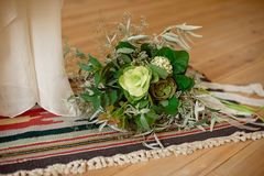 Slightly disheveled fresh and airy bridal bouquet with veronica and eucalyptus will be a great addition to the image of a stylish. Bride, boho, wedding, floral stock photo