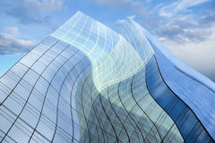 Glass building on blue sky Royalty Free Stock Photo