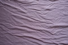 Slightly jammed pink viscose fabric. From above Royalty Free Stock Image