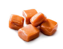 Slightly melted toffee caramel candy close-up isolated with clipping path on white Royalty Free Stock Image