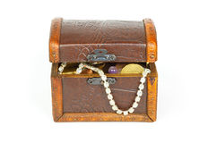 Slightly opened treasure chest with bracelet, coins and pearls Royalty Free Stock Photography