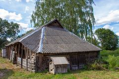 Old outbuildings and an abandoned dog house stock image