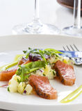 Slightly salted salmon. Gravlax serverd with a fresh potato and apple salad Royalty Free Stock Photography
