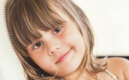 Slightly smiling Caucasian little girl, close up Stock Photography