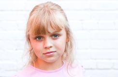 Slightly smiling little blond beautiful girl Royalty Free Stock Photos