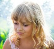 Slightly smiling little blond girl Stock Image