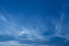 Sligtly clouds floating on the clear blue sky Royalty Free Stock Images