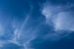 Sligtly clouds floating on the clear blue sky Royalty Free Stock Image