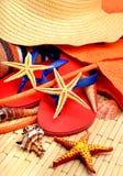 Sliipers, starfish, beach hat, towel on a wood Stock Photo
