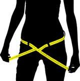 Slim. Measuring woman - get slim now Royalty Free Stock Image