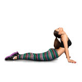 Slim adult sexy female doing stretching on fitness Royalty Free Stock Photos