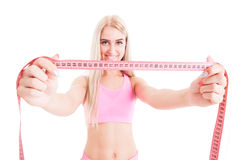 Slim aerobic woman holding pink meter Royalty Free Stock Photos