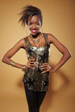 Slim african woman with arms akimbo. Happy slim african woman with her arms akimbo Stock Images