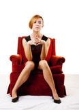 Slim Asian American Woman Sitting In Chair Stock Photo