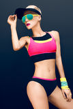 Slim athletic fitness blonde on a black background in the fashio Stock Images