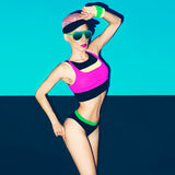 Slim athletic girl in bright trendy sportswear. Fitness Fashion Royalty Free Stock Photo