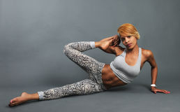 Slim athletic girl doing stretching Stock Photos