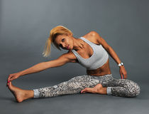 Slim athletic girl doing stretching Royalty Free Stock Photography