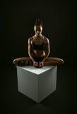 Slim athletic woman doing stretching yoga exercise Stock Images