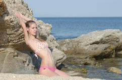 Slim attractive blonde on beach wear bikini Royalty Free Stock Photography