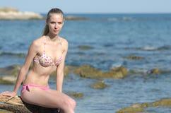 Slim attractive blonde on beach wear bikini Stock Image