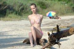 Slim attractive blonde on beach wear bikini Royalty Free Stock Photos