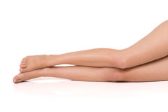 Slim and attractive legs of beautiful woman on white background. Royalty Free Stock Photography