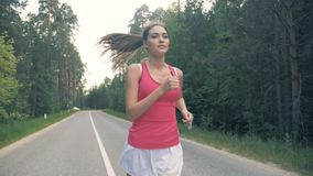Slim attractive woman during running, steadicam, slow motion. stock video