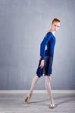 Slim ballerina in a blue dress dancing. Stock Photo