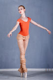 Slim ballerina rehearsing dance. On tiptoe. Royalty Free Stock Images