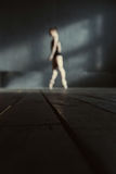 Slim ballet dancer standing on the tiptoes in the studio Royalty Free Stock Images