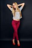Slim beautiful girl in the studio Royalty Free Stock Image