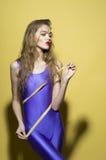 Slim beautiful girl with tape measure Royalty Free Stock Photos