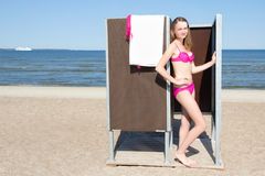 Slim beautiful woman in changing cabin on the beach Royalty Free Stock Photo