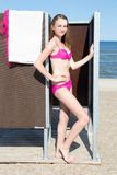 Slim beautiful woman in dressing cabin on the beach. Young slim beautiful woman in dressing cabin on the beach Stock Photography