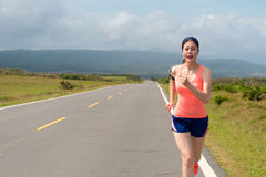 Slim beautiful woman every morning sporting. To running on a clean road listen to music training the body efforts to maintain the body with copyspace Stock Photos