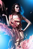 Slim beautiful woman in pink dress Stock Photos