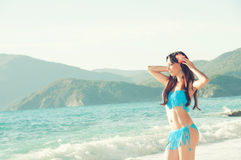Slim beautiful woman on the sea coast looking Stock Photography