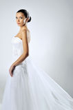 Slim beautiful woman wearing luxurious wedding dress Royalty Free Stock Photography