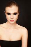 Slim beauty. Young beautiful slim model with smoky eyes Stock Photography