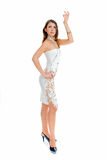 Slim and beauty. Young adult beauty girl in dancing pose on white Stock Photos