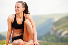 Slim beauty woman relaxing after training. Slim beauty woman relaxing after outdoor training Royalty Free Stock Images