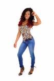 Slim black woman dancing. Royalty Free Stock Photo