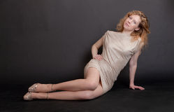 Slim blonde in a dress Royalty Free Stock Image